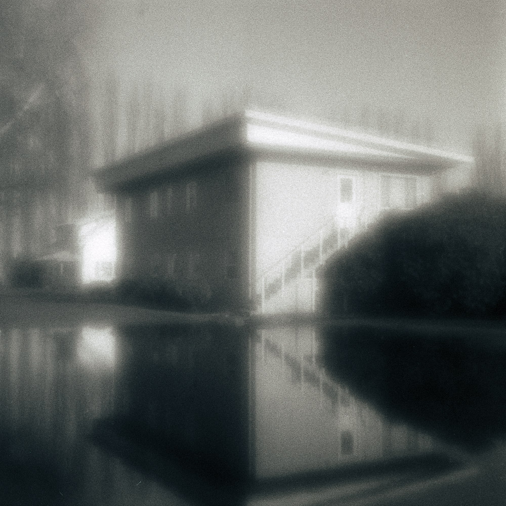Melancholy and Reflection of a Building on the Block
